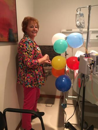 A IV bag holder is way more fun with balloons
